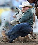 Sterling Wallace competes in the steer wrestling competition at the Reno Rodeo in Reno, Nev., on Friday, June 20, 2014.<br />