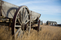 Abandoned equipment and buildings stand at an old homestead in a farm field north of Rudyard, Montana, USA.