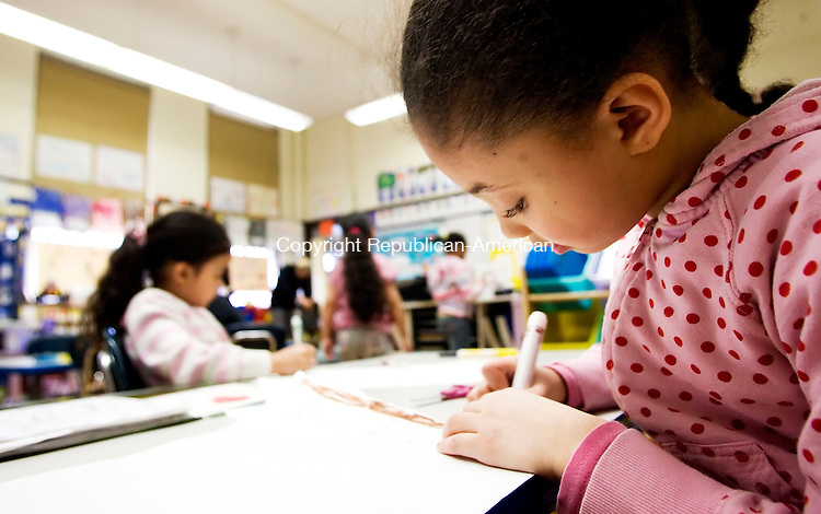 BOSTON, MA- 03 APR 07- 040307JT06- <br /> Kindergartener Zayla Goncalves draws a picture during choice time during her school day at Samuel Mason Elementary School in Roxbury, Mass. on Tuesday, Apr. 3.<br /> Josalee Thrift Republican-American