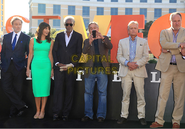 Kevin Kline, Mary Steenburgen, Morgan Freeman, Robert DeNiro, Michael Douglas<br /> &quot;Last Vegas&quot; cast received the key to Vegas at the Bellagio Fountain, Las Vegas, NV, USA, 18th October 2013.<br /> full length green dress suit cast jeans beige brown grey gray blue iphone taking photo picture <br /> CAP/ADM/MJT<br /> &copy; MJT/AdMedia/Capital Pictures