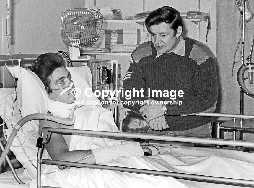 Private Ian Jackson, 1 Bn Light Infantry, is visited by Sergeant Bill Watt, Royal Army Medical Corps, the paramedic who saved his life with an on-the-spot tracheotomy when he was seriously injured in a Provisional IRA bomb attack on Crossmaglen Police Station, 28th August 1973. The photo was taken the following day in the Military Wing of Musgrave Park Hospital, Belfast. 197310290660b<br /> <br /> Copyright Image from Victor Patterson, 54 Dorchester Park, Belfast, UK, BT9 6RJ<br /> <br /> Tel: +44 28 9066 1296<br /> Mob: +44 7802 353836<br /> Voicemail +44 20 8816 7153<br /> Email: victorpatterson@me.com<br /> Email: victorpatterson@gmail.com<br /> <br /> IMPORTANT: My Terms and Conditions of Business are at www.victorpatterson.com
