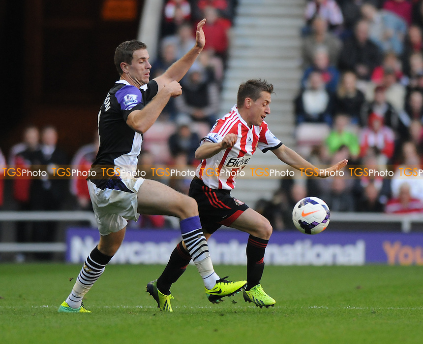 Jordan Henderson of Liverpool battles with Emanuele Giaccherini of Sunderland - Sunderland vs Liverpool - Barclays Premier League Football at the Stadium of Light, Sunderland - 29/09/13 - MANDATORY CREDIT: Steven White/TGSPHOTO - Self billing applies where appropriate - 0845 094 6026 - contact@tgsphoto.co.uk - NO UNPAID USE<br />   i