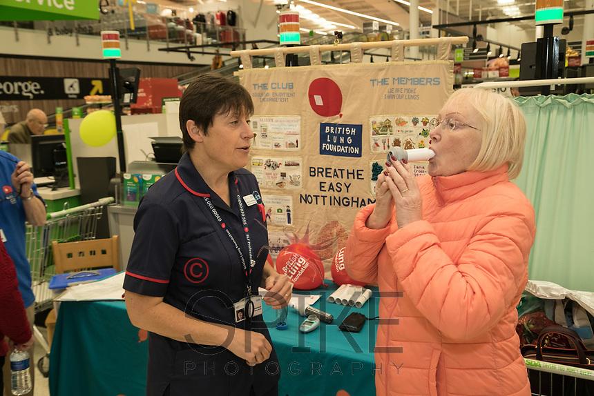 Specialist Respiratory Nurse Alison Sutherland demonstrates the Spirometer test to Asda customer Sandra Speyers of Edwalton