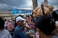 March 31, 2012 - Phnom Penh, Cambodia. Factory workers leave work after finishing their shift. © Nicolas Axelrod / Ruom