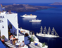 Greece; Cyclades; Santorini; Fira (Thira): breakfast with view across the Caldera, cruise ships / clipper and island Nea Kameni