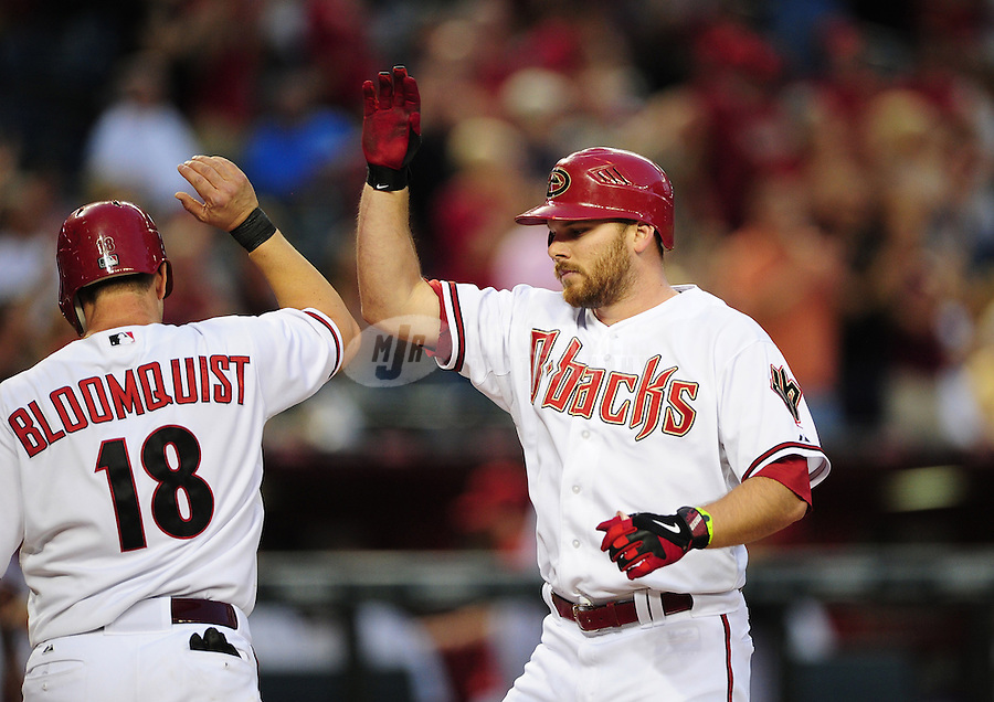 Jun. 8, 2012; Phoenix, AZ, USA; Arizona Diamondbacks outfielder Jason Kubel (right) is congratulated by Willie Bloomquist after hitting a two run home run in the second inning against the Oakland Athletics at Chase Field.  Mandatory Credit: Mark J. Rebilas-