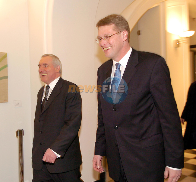 Dublin Ireland. Prime Minister of Finland, H.E. Mr. Matti van Hanen (R) walking with Irish Prime Minister and president of the EU Bertie Ahern before there meeting in Government Buildings Dublin, Ireland 23th February 2004.Photo AFP/NEWSFILE/FRAN CAFFREY..(Photo credit should read FRAN CAFFREY/NEWSFILE/AFP)...This Picture has been sent you under the condtions enclosed by:.Newsfile Ltd..the Studio,.Millmount Abbey,.Drogheda,.Co Meath..Ireland..Tel: +353(0)41-9871240.Fax: +353(0)41-9871260.GSM: +353(0)86-2500958.email: pictures@newsfile.ie.www.newsfile.ie.FTP: 193.120.102.198..This picture is from Fran Caffrey@newsfile.ie