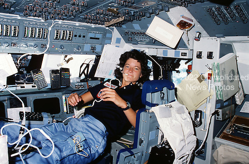 Astronaut Sally K. Ride, STS-7 mission specialist, performs a number of functions simultaneously, proving the necessity for versatility and dexterity in space travel on June 21, 1983. Floating freely on the flight deck, Dr. Ride communicates with ground controllers in Houston, moves within feet of important reference data, hand calculators and other aids all at the same time. She is one of the five astronaut crewmembers for the Challenger's second orbital mission. Her head is in the station normally occupied by the pilot (in this case, Federick H. (Rick) Hauck) and her feet are anchored at the station for the crew commander (in this case, Robert L. Crippen). Dr. Ride passed away due to Pancreatic Cancer on Monday, July 23, 2012..Credit: NASA via CNP