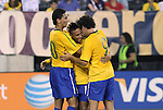 10 AUG 2010: Neymar (BRA) (center) is congratulated for scoring a goal by teammates Paulo Henrique Ganso (10) and Alexandre Pato (9). The United States Men's National Team lost to the Brazil Men's National Team 0-2 at New Meadowlands Stadium in East Rutherford, New Jersey in an international friendly soccer match.
