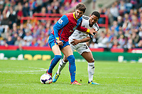 Sun 22 September 2013<br /> <br /> Pictured: Jose Campaaa of Crystal Palace and Jonathan de Guzman  of Swansea go for the ball <br /> <br /> Re: Barclays Premier League Crystal Palace FC  v Swansea City FC  at Selhurst Park, London