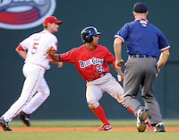 July 29, 2009: Minor League stolen base leader Anthony Gose (24) of the Lakewood BlueClaws is caught off second base as he attempted to steal his 58th base in the fifth inning of a game at Fluor Field at the West End in Greenville, S.C. The Drive's Will Middlebrooks applied the tag. Photo by: Tom Priddy/Four Seam Images