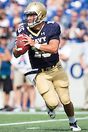 Annapolis, MD - SEPT 10, 2016: Navy Midshipmen quarterback Will Worth (15) rolls out of the pocket during their match up against Connecticut at Navy-Marine Corps Memorial Stadium in Annapolis, MD. Navy held on to defeat Connecticut 28-24. (Photo by Phil Peters/Media Images International)