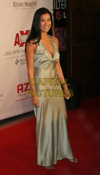 LISA LING.The 2006 Asian Excellence Awards, Los Angeles, California..January 19th, 2006.Photo: Zach Lipp/AdMedia/Capital Pictures.Ref: ZL/ADM.full length green silk satin dress.www.capitalpictures.com.sales@capitalpictures.com.© Capital Pictures.