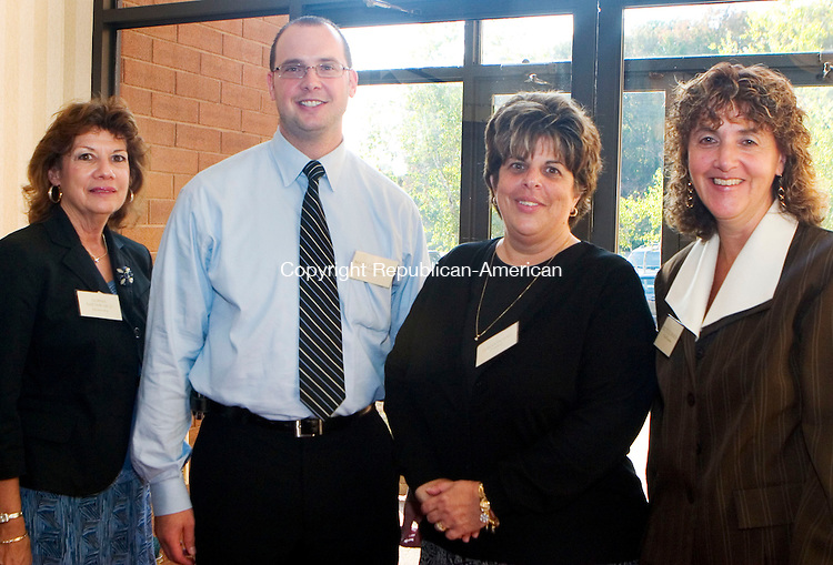 WATERBURY, CT- 04 OCT 2007- 100407JT09- <br /> Norma Napomiceno, second vice president Matt Calabrese, Donna Vignali, and first vice president Bettie Gedraitis during a dinner for new teachers at the Connecticut Grand Hotel in Waterbury on Thursday, Oct. 4.<br /> Josalee Thrift / Republican-American