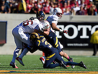 California defenders' Nathan Broussard and Kameron Jackson tackle Stanford Tight End Zach Ertz during 115th Big Game at Memorial Stadium in Berkeley, California on October 20th, 2012.  Stanford defeated California, 21-3.
