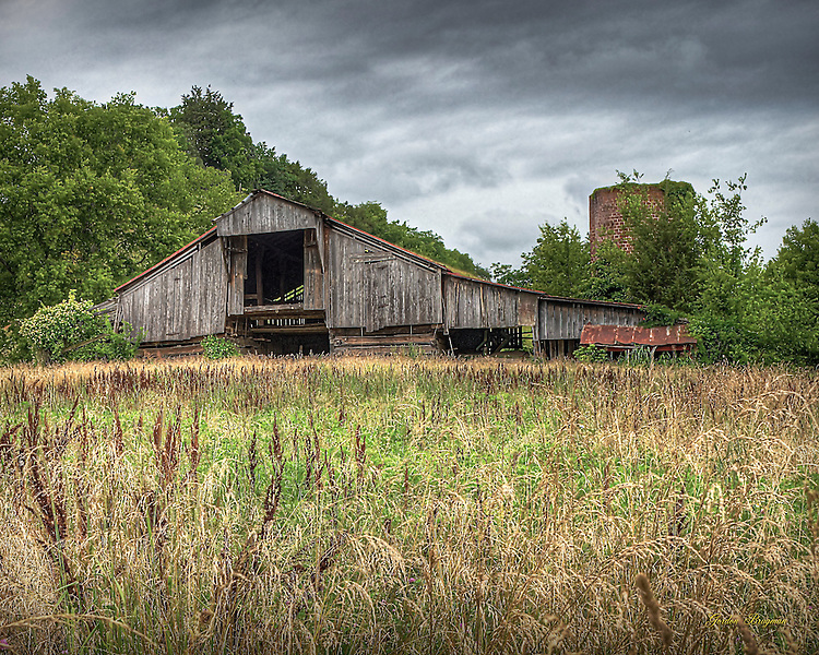 Old Barn and a fallow field. Three-exposure HDR.