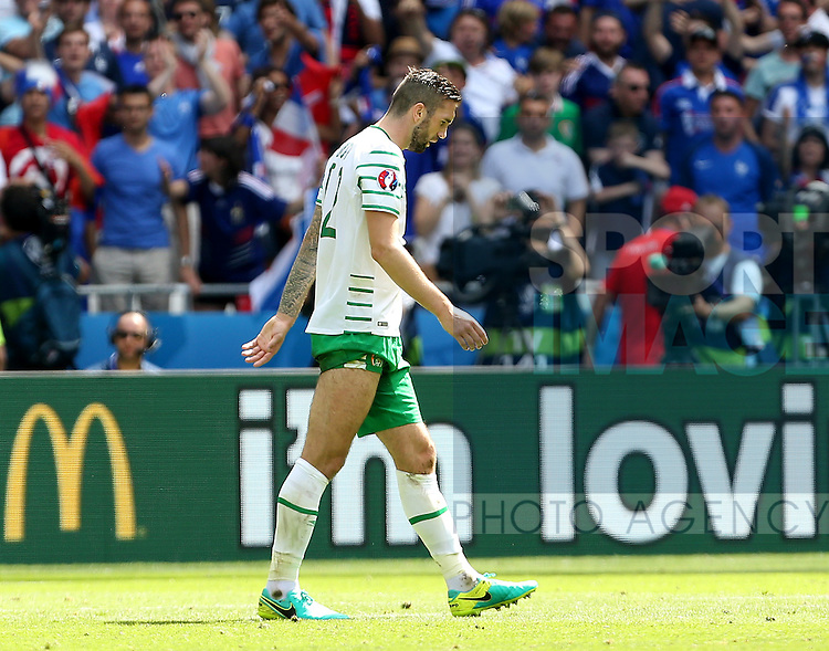 Shane Duffy of Ireland walks off after he received a red card during the UEFA European Championship 2016 match at the Stade de Lyon, Lyon. Picture date June 25th, 2016 Pic Phil Oldham/Sportimage