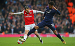 Arsenal's Dani Ceballos is challenged by West Ham's Sebastien Haller during the Premier League match at the Emirates Stadium, London. Picture date: 7th March 2020. Picture credit should read: Paul Terry/Sportimage