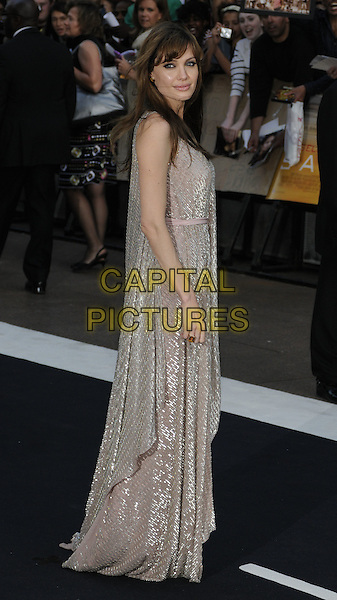 "ANGELINA JOLIE .Attending the UK Film Premiere of ""Salt"", Empire cinema, Leicester Square, London, England, UK, .August 16th 2010..full length long maxi dress gold silver beige sequined sequin nude pink straps sleeveless side  beaded.CAP/CAN.©Can Nguyen/Capital Pictures."
