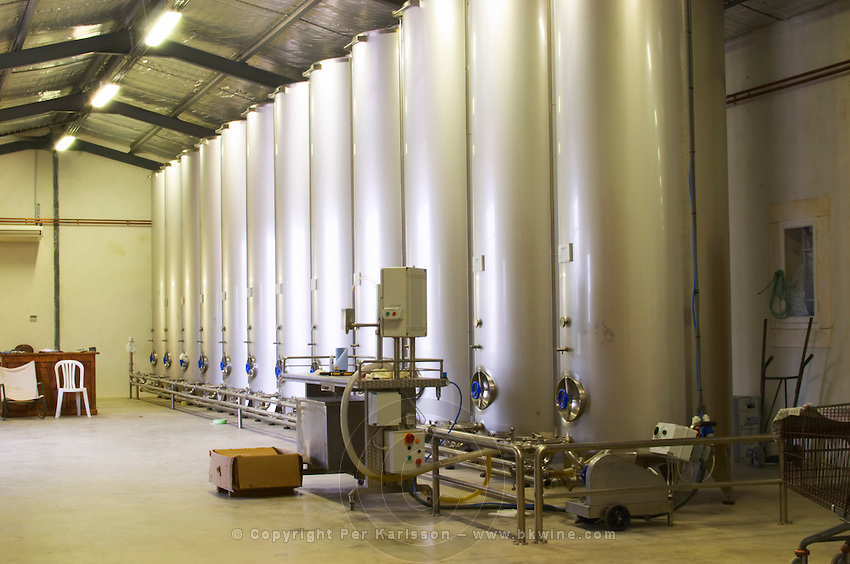 In the olive factory, tanks for storing olive oil. Moulin Mas des Barres olive mill, Maussanes les Alpilles, Bouches du Rhone, Provence, France, Europe