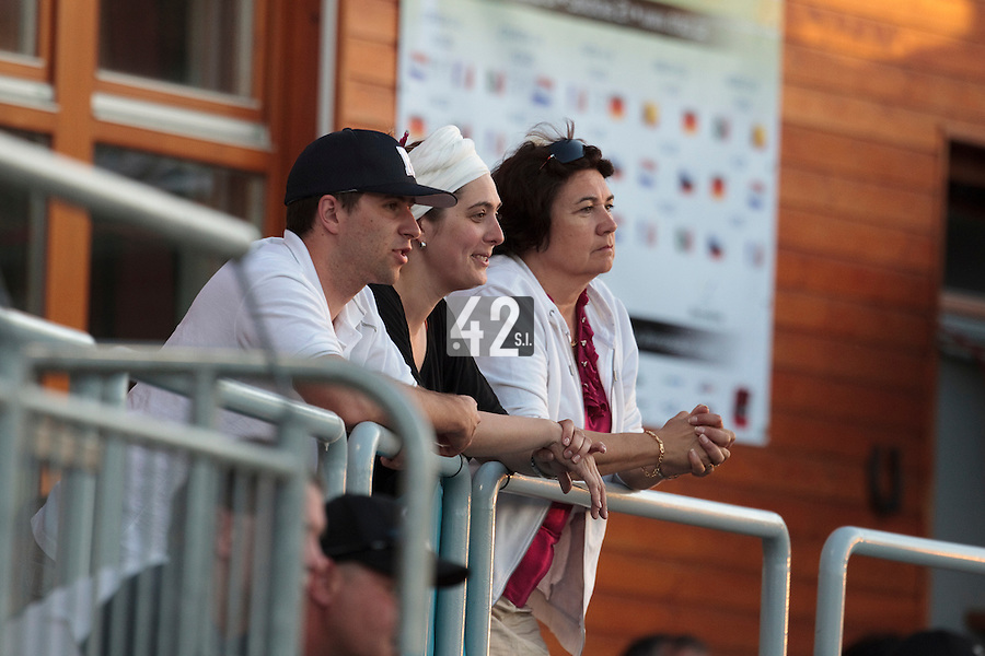 05 June 2010: Julien Leseur, StÈphanie Raulet and Sylvie Becquey  are seen watching the game and cheering for Rouen during the 2010 Baseball European Cup match won 10-0 by Fortitudo Bologna over the Rouen Huskies, at the AVG Arena, in Brno, Czech Republic.