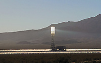 Ivanpah Solar Power Facility. This $2.2 billion project in the Mojave Desert 40 milies southwest of Las Vegas is the world's largest solar thermal power plant. The project began operation in February 2014. It uses 173,500 heliostats, each with two mirrors, to focus solar energy on boilers located on three towers. The boilers. which glow like mini-suns, convert water to steam. The steam  drives conventional turbines. San Bernardino Co., Calif.