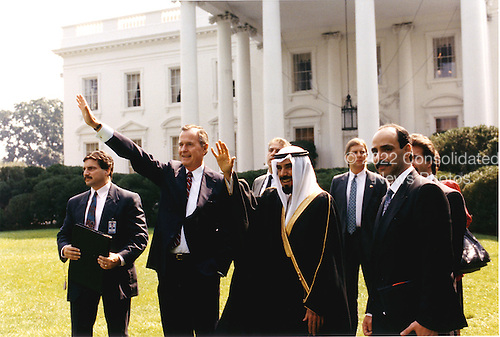 Washington, D.C. - September 28, 1990 -- United States President George H.W. Bush and His Highness Jabir al-Ahmad al-Jabir al-Sabah, the Emir of Kuwait wave to supporters from the north lawn of the White House in Washington, D.C. on September 28, 1990..Credit: White House via CNP