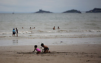 Pictured: Children play on the sand. Saturday 01 July 2017<br /> Re: National Wales Air Show in Swansea Bay, Wales, UK.