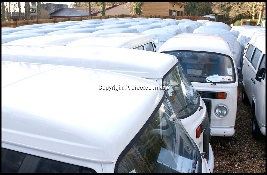 BNPS.co.uk (01202 558833)<br /> Pic: LauraJones/BNPS<br /> <br /> Just some of the last delivery of VW campervans. <br /> <br /> The last ever delivery of brand new Volkswagen campervans has arrived in Britain marking the end of an era for the iconic 'hippy bus'.<br /> <br /> Ninety nine of the final batch of vans rolled off the production line and onto a container ship bound for British shores after manufacture ceased for good in Brazil in December.<br /> <br /> And though the consignment has only just arrived, almost all of the vans have already been snapped up by eager buyers happy to fork out the &pound;35,000 starting price.<br /> <br /> They are the last brand new campers in all of Europe.