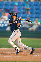 Gabriel Garcia (4) of the Helena Brewers follows through on his swing against the Great Falls Voyagers at Centene Stadium on August 18, 2017 in Helena, Montana.  The Voyagers defeated the Brewers 10-7.  (Brian Westerholt/Four Seam Images)