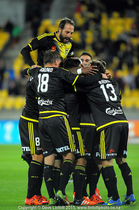 The Phoenix celebrate Roly Bonevacia's second goal during the A-League football match between Wellington Phoenix and Adelaide United at Westpac Stadium, Wellington, New Zealand on Friday, 13 November 2015. Photo: Dave Lintott / lintottphoto.co.nz
