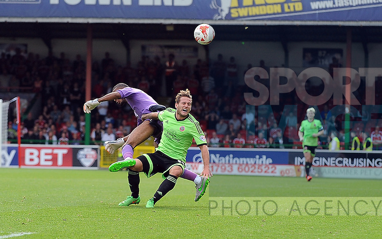 Billy Sharp of Sheffield United is fouled by Swindon Town goalkeeper Lawrence Vigouroux<br /> - English League One - Swindon Town vs Sheffield Utd - County Ground Stadium - Swindon - England - 29th August 2015 <br /> --------------------