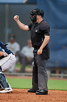 Umpire Conor McKenna calls a strike during a Gulf Coast League game between the GCL Pirates  and GCL Rays on August 7, 2019 at Charlotte Sports Park in Port Charlotte, Florida.  (Mike Janes/Four Seam Images)