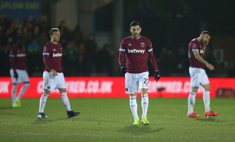 Dejection for West Ham players<br /> <br /> Photographer Rob Newell/CameraSport<br /> <br /> Emirates FA Cup Fourth Round - AFC Wimbledon v West Ham United - Saturday 26th January 2019 - Kingsmeadow Stadium - London<br />  <br /> World Copyright © 2019 CameraSport. All rights reserved. 43 Linden Ave. Countesthorpe. Leicester. England. LE8 5PG - Tel: +44 (0) 116 277 4147 - admin@camerasport.com - www.camerasport.com