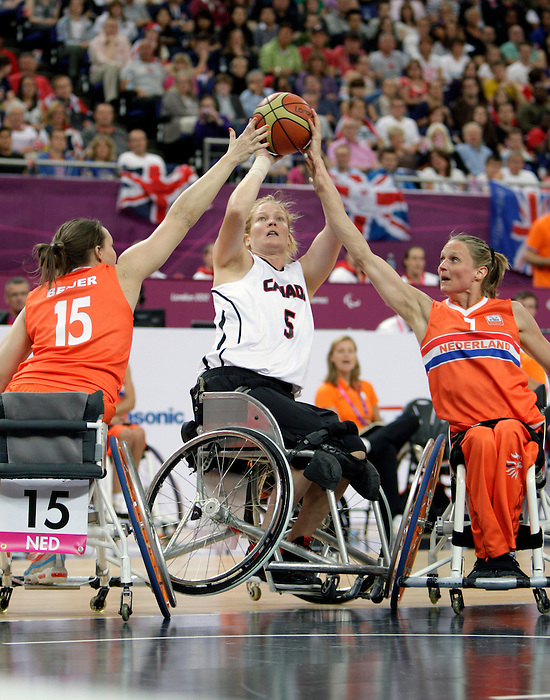 LONDON, ENGLAND 08/31/12: Janet McLachlan competes in the Women's Wheelchair Basketball preliminary round CAN vs NED at the London 2012 Paralympic Games at the North Greenwich Arena (Photo by: Wheelchair Basketball Canada/Canadian Paralympic Committee)