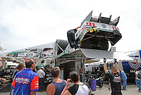 Apr. 26, 2013; Baytown, TX, USA: Crew members unload the car of NHRA funny car driver John Force in the pits during qualifying for the Spring Nationals at Royal Purple Raceway. Mandatory Credit: Mark J. Rebilas-