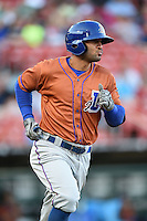 Durham Bulls outfielder Justin Christian (15) runs to first during a game against the Buffalo Bisons on July 10, 2014 at Coca-Cola Field in Buffalo, New  York.  Durham defeated Buffalo 3-2.  (Mike Janes/Four Seam Images)