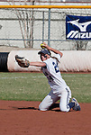 April 20, 2012:   Nevada Wolf Pack shortstop Karley Hopkins makes the throw to first from her knees against the University of Hawai'i Warrior during their NCAA softball game played at Christina M. Hixson Softball Park on Friday in Reno, Nevada.