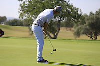 Marcel Siem (GER) putts on the 9th green during Thursday's Round 1 of the 2016 Portugal Masters held at the Oceanico Victoria Golf Course, Vilamoura, Algarve, Portugal. 19th October 2016.<br /> Picture: Eoin Clarke | Golffile<br /> <br /> <br /> All photos usage must carry mandatory copyright credit (&copy; Golffile | Eoin Clarke)