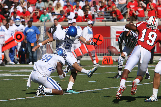UK's Ryan Tydlacka kicks an extra point against the University of Louisville at Papa John's Cardinal Stadium on Saturday, Sept. 4, 2010. Photo by Scott Hannigan | Staff
