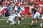 UK's Ryan Tydlacka kicks an extra point against the University of Louisville at Papa John's Cardinal Stadium on Saturday, Sept. 4, 2010. Photo by Scott Hannigan   Staff