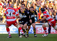 Mark van Gisbergen attracts the attention of Will James and Alasdair Strokosch as he attempts to break through the Gloucester defence. Guinness Premiership match between London Wasps and Gloucester on March 7, 2010 at Adams Park in High Wycombe, England. [Mandatory Credit: Patrick Khachfe/Onside Images]