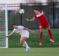 Abby Wambach (20) of the Western NY Flash goes up for a header with Ali Krieger (11) of the Washington Spirit during the game at the Maryland SoccerPlex in Boyds, MD.  Washington tied Western NY, 1-1.