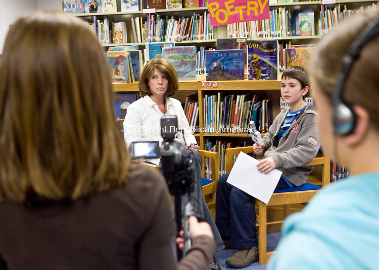 SOUTHBURY, CT - 30 MARCH 2009 -033009JT03-<br /> Elijah Bova interviews library tech aide Wendy Gaipa as Samantha Kimball records them on video and Alex Barrere monitors audio during a short class for 5th graders at Gainfield Elementary School on Monday. The work done by the students, including interviews and related footage, will be shown on Region 15's &quot;inside the District&quot; television show.  <br /> Josalee Thrift Republican-American