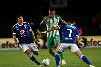 BOGOTÁ - COLOMBIA, 11-01-2019: Roberto Ovelar (Izq.) y Óscar Barreto (Der.) jugadores de Millonarios disputan el balón con Brayan Rovira (Cent.) jugador de Atlético Nacional, durante partido entre Millonarios y Atlético Nacional, por el Torneo Fox Sports 2019, jugado en el estadio Nemesio Camacho El Campin de la ciudad de Bogotá. / Roberto Ovelar (L) and Oscar Barreto (R) players of Millonarios struggle for the ball with Brayan Rovira (C) player of Atletico Nacional, during a match between Millonarios y Atletico Nacional, for the Fox Sports Tournament 2019, played at the Nemesio Camacho El Campin stadium in the city of Bogota. Photo: VizzorImage / Luis Ramírez / Staff.