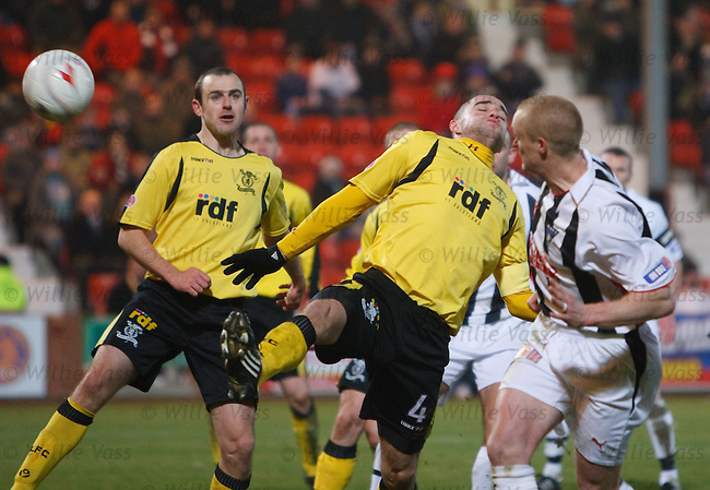 Greg Shields cuts the ball back across the face of the goal to score a contoversal goal for Dunfermline