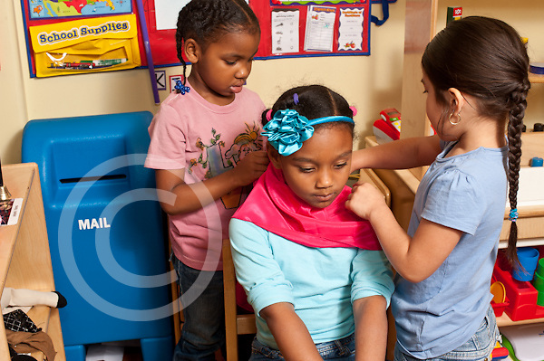Education Preschool Headstart pretend play girls giving another girl a hair cut or new hair style