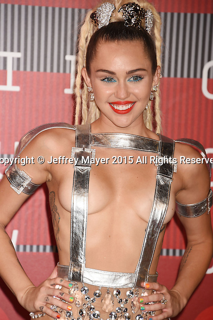 LOS ANGELES, CA - AUGUST 30: Singer/actress MIley Cyrus arrives at the 2015 MTV Video Music Awards at Microsoft Theater on August 30, 2015 in Los Angeles, California.
