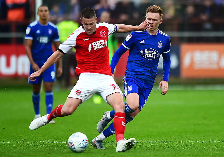 Fleetwood Town's Paul Coutts competes with Ipswich Town's Jon Nolan<br /> <br /> Photographer Richard Martin-Roberts/CameraSport<br /> <br /> The EFL Sky Bet League One - Fleetwood Town v Ipswich Town - Saturday 5th October 2019 - Highbury Stadium - Fleetwood<br /> <br /> World Copyright © 2019 CameraSport. All rights reserved. 43 Linden Ave. Countesthorpe. Leicester. England. LE8 5PG - Tel: +44 (0) 116 277 4147 - admin@camerasport.com - www.camerasport.com