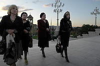 Women arrive at the Sameba Cathedral in Tbilisi....